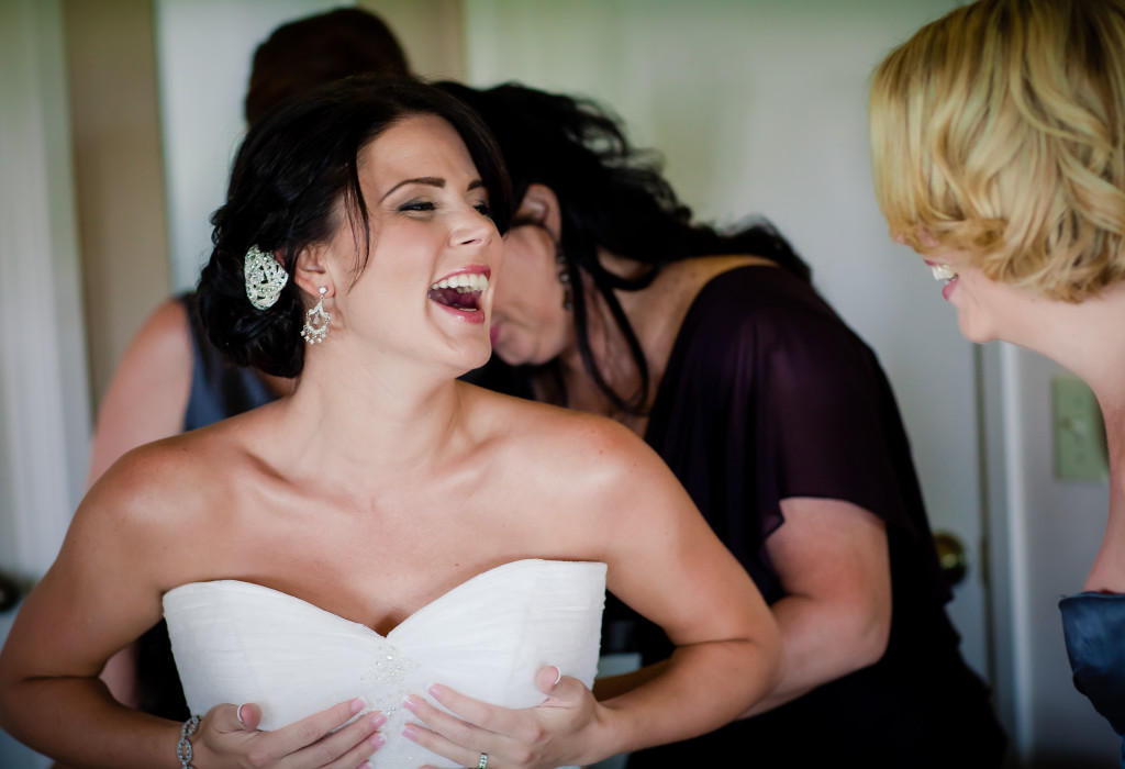 Bridal party helps bride get dressed