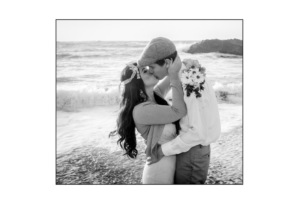 Bride and groom kiss at the beach